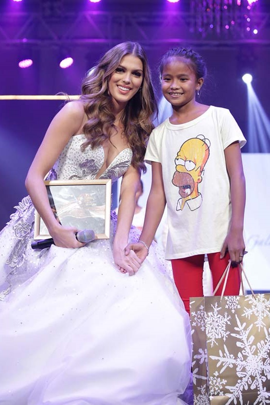 Our Student Allesandra walking the runway with Miss Universe 2016 Iris Mittenaere