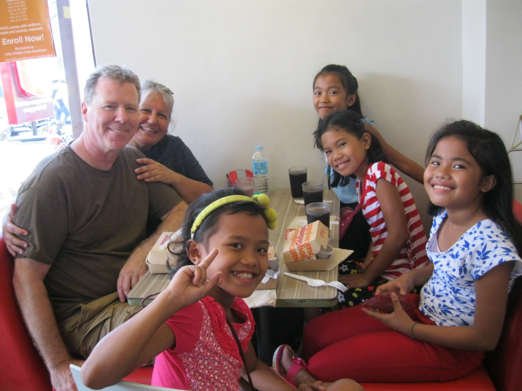 Paul & Vanessa Grimsland with sponsored elementary students in Batangas